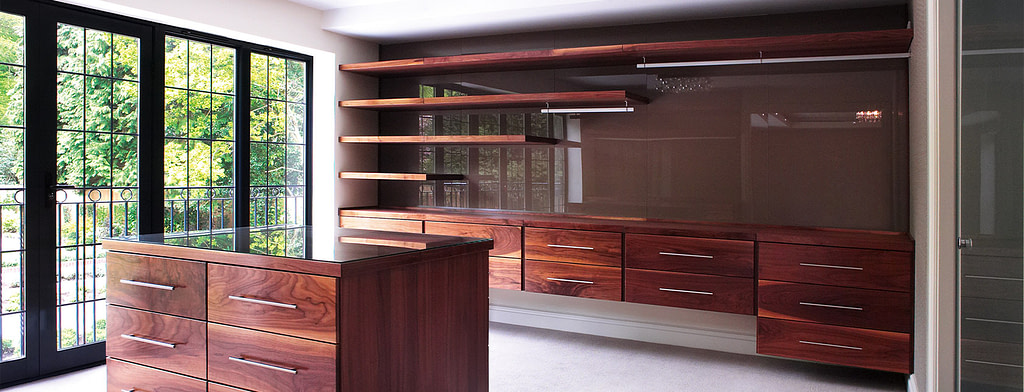 Custom walk-in wardrobes with free-floating drawers and shelves