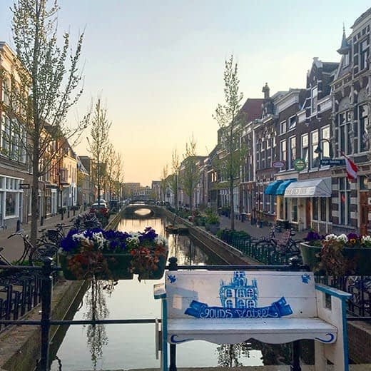 A picturesque canal view in Gouda, from the Telescope Style blog, Holland in Springtime.