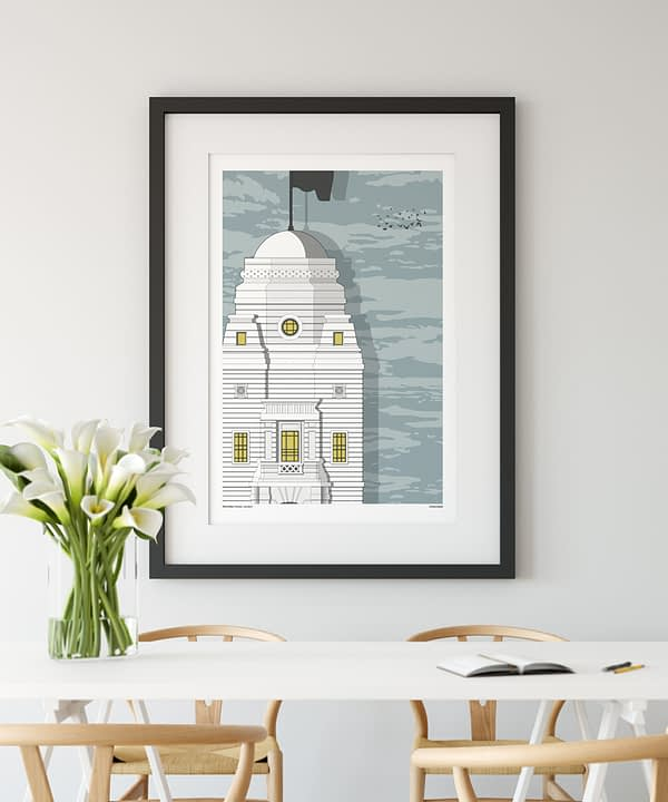 A print of the original Wembley stadium shown in a modern dining room setting.
