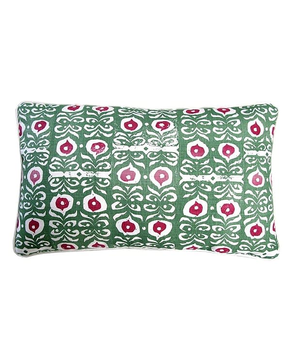 A rectangular, hand-printed linen green patterned cushion inspired by Middle Eastern motifs in red and green.