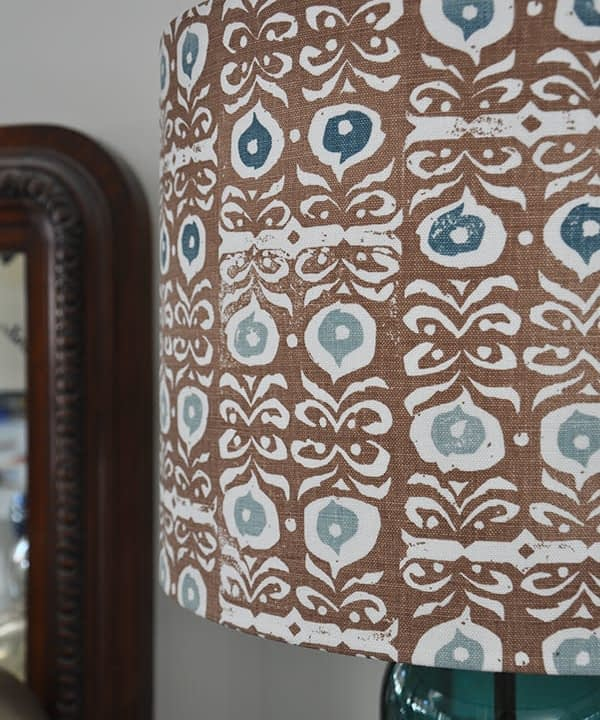 Close up shot of a patterned lampshade in cinnamon brown and teal blue.