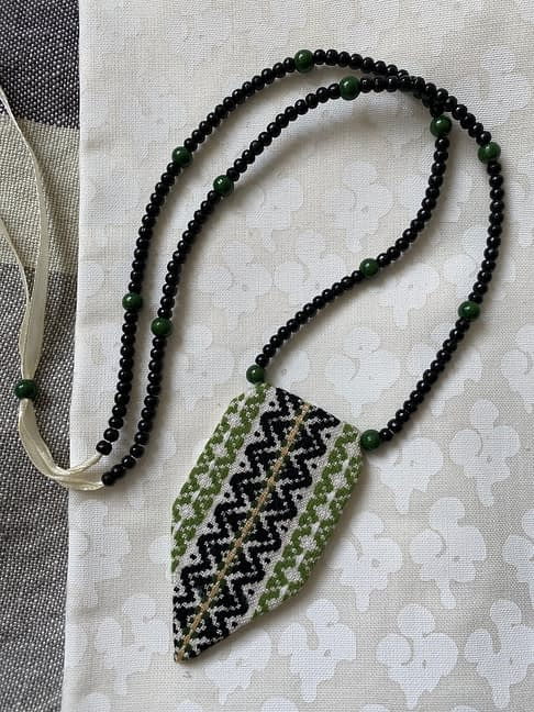 Statement green necklace, handmade from vintage embroidered textiles with an adjustable drop, in black, white and green.