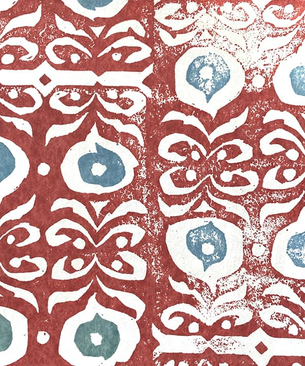 Detail of a bold, red wallpaper for walls with soft blue accents.