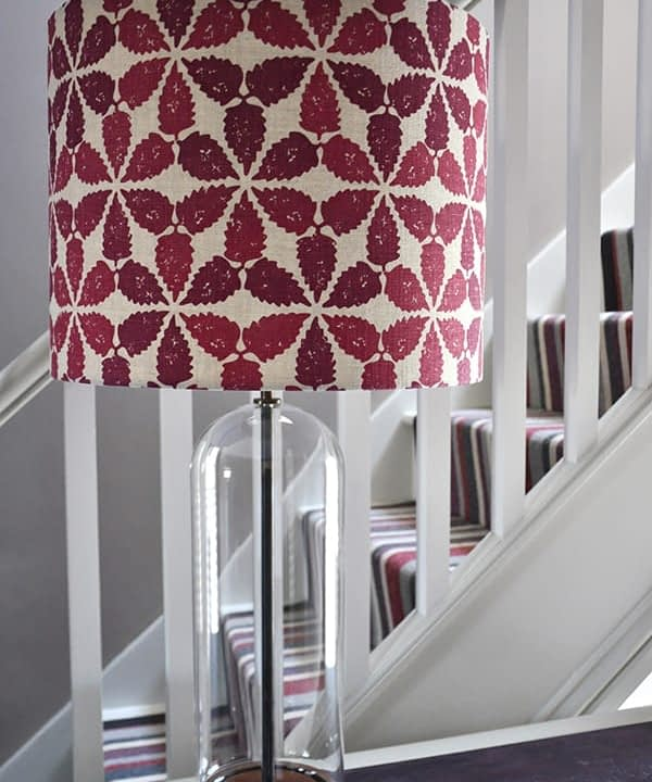 Detail shot of a red patterned lampshade in 'Maroc'.