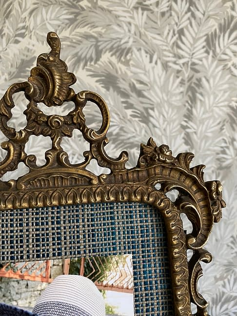 Detail of a large, vintage, brass, photograph frame.