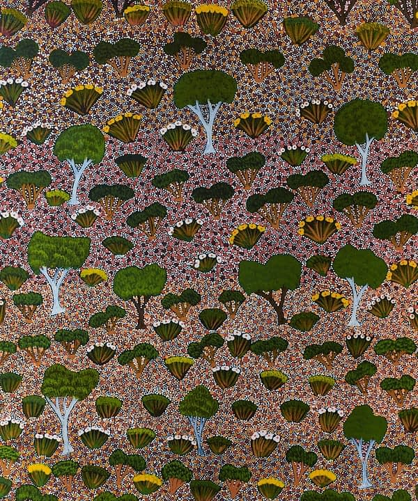 Native trees and flora of the Australian Outback captured in an Aboriginal dot painting wallpaper design.