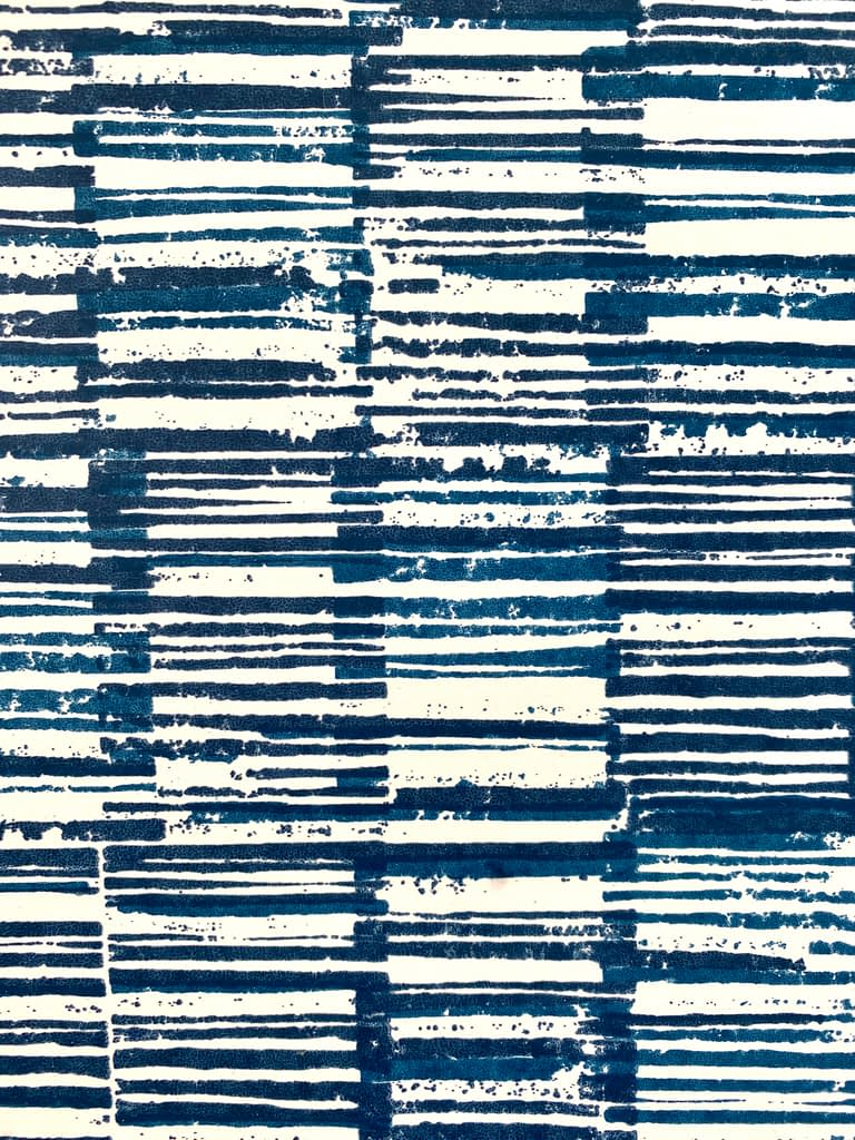 Japanese style wallpaper detail in indigo blue, with a hand-printed geometric pattern.
