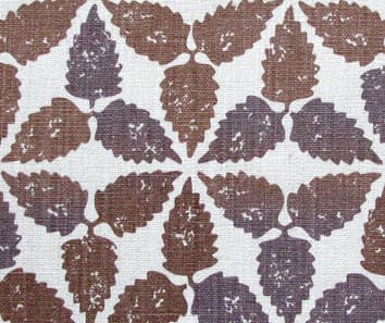 A brown patterned cushion fabric, hand-printed on linen and available as handmade cushions in two sizes.