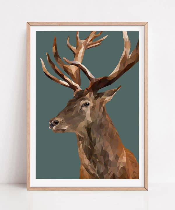 Stag print with a jungle teal background and pale wooden frame.