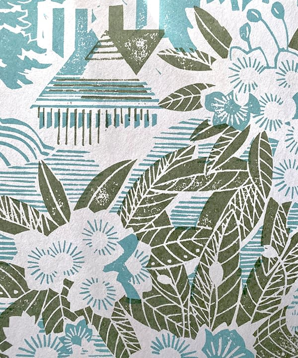 Detail of a country garden wallpaper in a soft peacock blue hue with sage green accents.