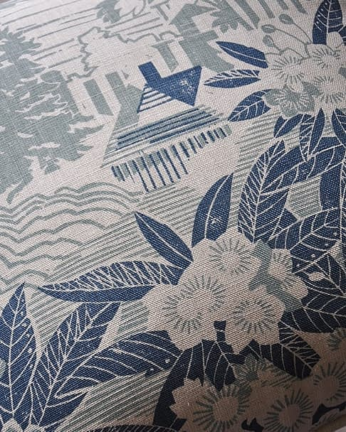 Detail of a pale blue floral cushion featuring an Arts & Crafts house in kits garden setting available through Telescope Style.