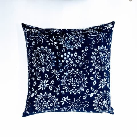 A vintage indigo cushion with flower circles design from Telescope Style.
