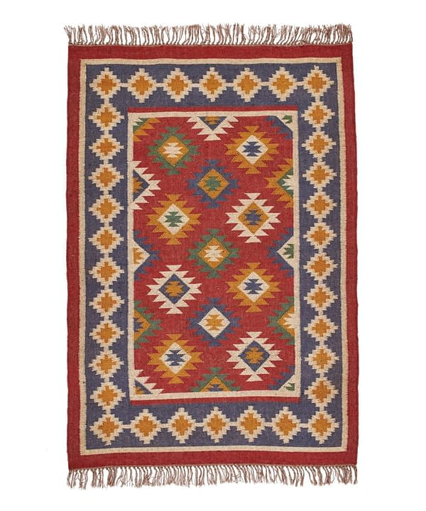 An Aztec, geometric red rug with blue border from Telescope Style.