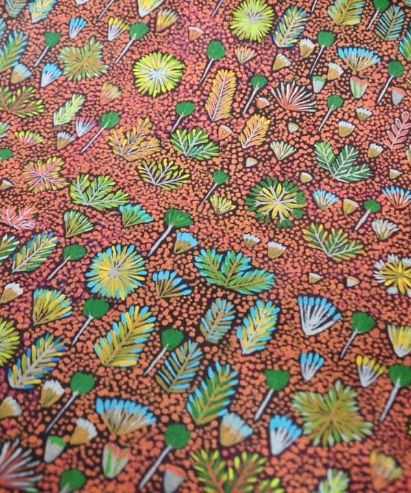'Daisy' Aboriginal art wallpaper in brown, available through Telescope Style.