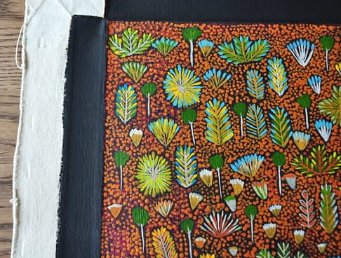 An original canvas painting that inspired 'Daisy' Aboriginal art wallpaper available through Telescope Style.