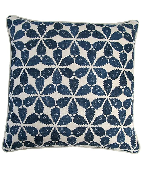 A cut out shot of an indigo patterned cushion made from hand-printed linen, Telescope Style.