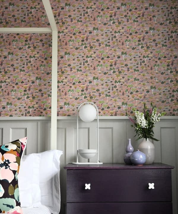 Pink trees and botanicals Aboriginal pastel wallpaper in a bedroom.