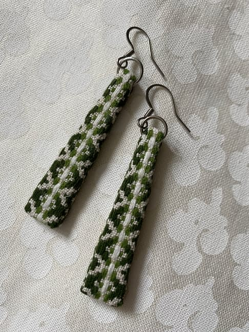 Green drop earrings, handmade from a vintage Slovenian textile, in black, white and green.