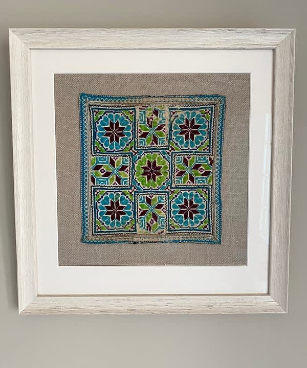 Square framed textile wall art from Northern Thailand.