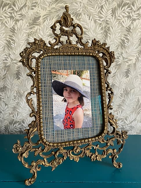 Vintage photo frame from Spain. Ornate Rococo-style scrolls in patinated brass.