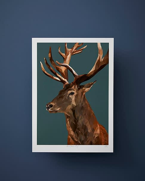 Stag print on a deep teal ground against a midnight blue wall.
