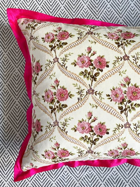 Vintage floral cushions with French-feel rosebud trellis design and hot pink, silk trim.