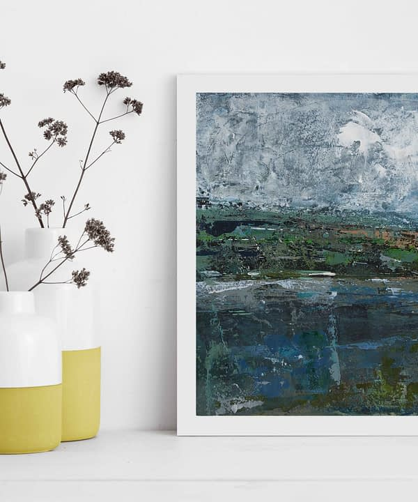 Irish landscapes art by Emma Tweedie, framed and styled next to colourful yellow jars filled with dried meadow flowers.