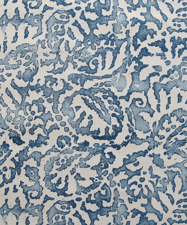 A close up of the Majolica, Italian-inspired, blue patterned wallpaper in Indigo with a pale, off-white ground.