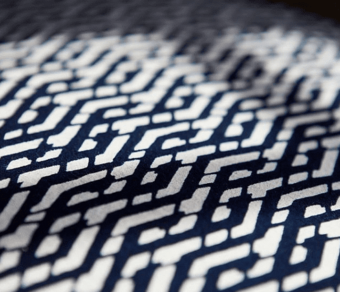 Detail of the indigo Eastern lattice print cushion fabric from Blue Handed through Telescope Style.