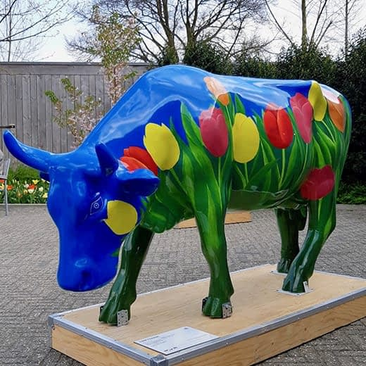 A tulip-painted cow sculpture at the Keukenhof in Holland.