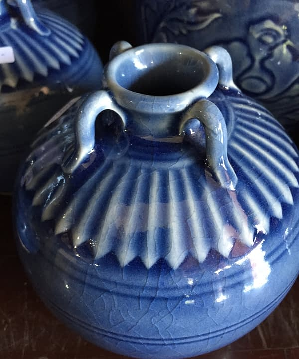 Small blue ceramic pot from Thailand showing the decorative detail and miniature urn handles.