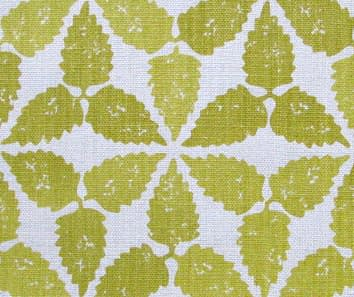 A yellow patterned cushion fabric in a Moroccan-inspired repeat hand-printed on linen.