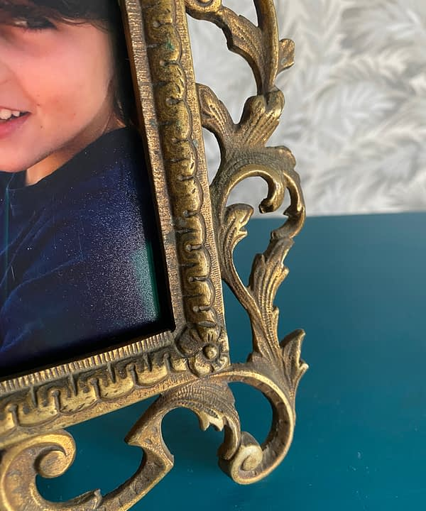 Acanthus leaves detail on a vintage, brass, photo frame.